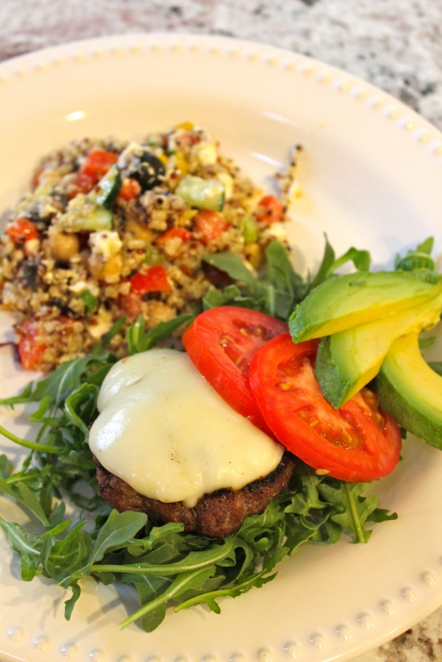 grass-feed beef cheeseburger, on a salad, no bun; quinoa greek salad
