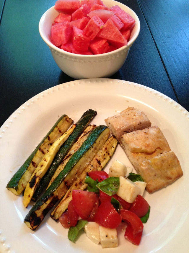 healthy summer meal: grilled zucchini; mahi mahi; caprese salad; watermelon