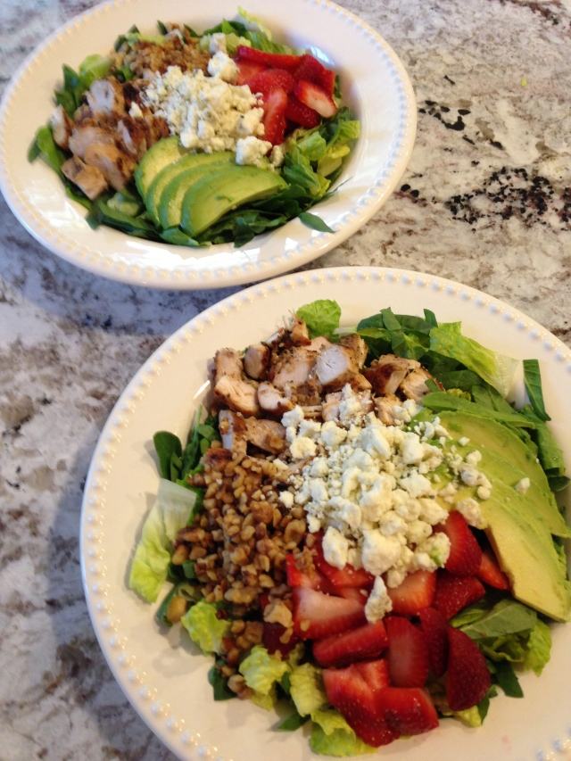 Salad with chicken, strawberries, walnuts, avocado and gorgonzola cheese