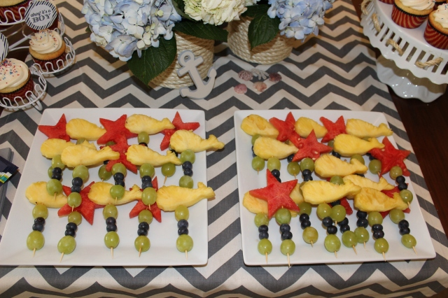 fruit and dessert for a baby boy shower; whale shaped pineapple