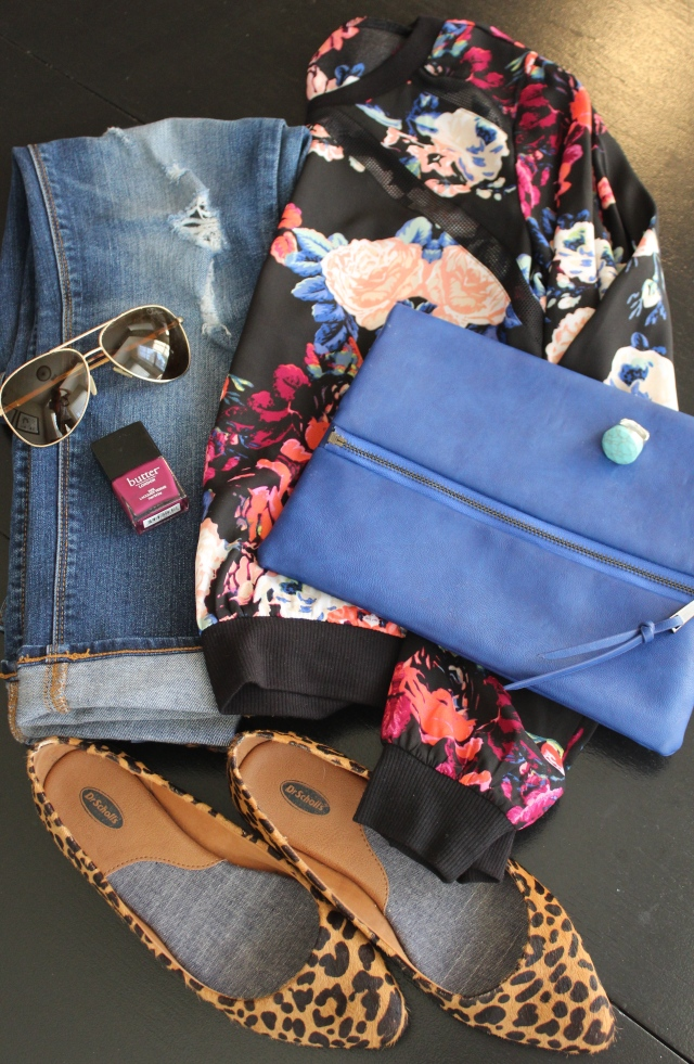 floral and black shirt; leopard flats; turquoise ring; cobalt blue clutch