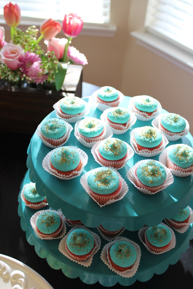 gold, turquoise and pink cupcakes for a baby shower