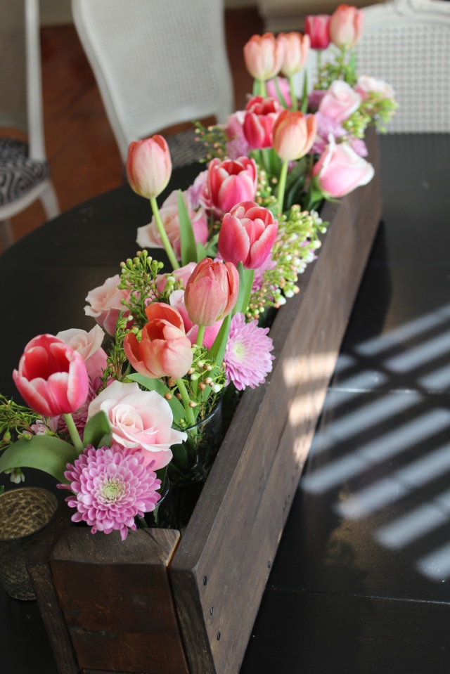 floral arrangement in rustic wooden box