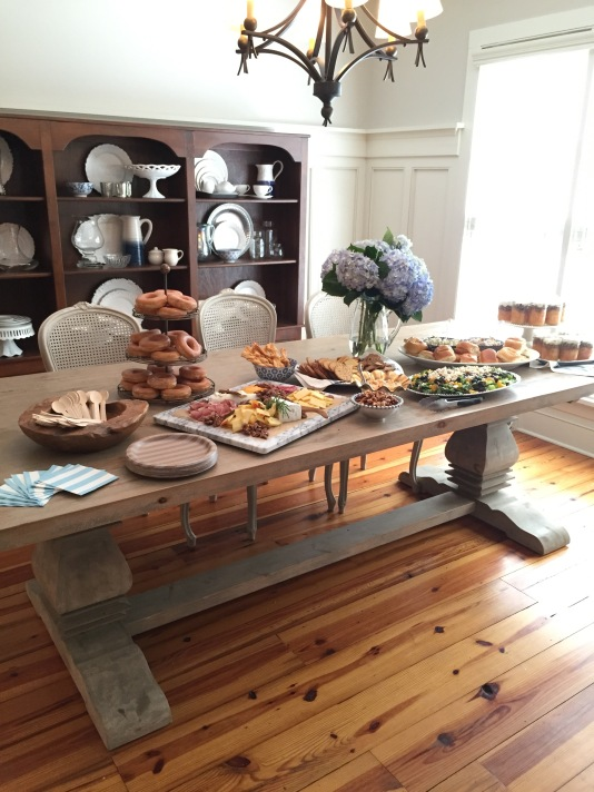 brunch on dining room table for a baby shower
