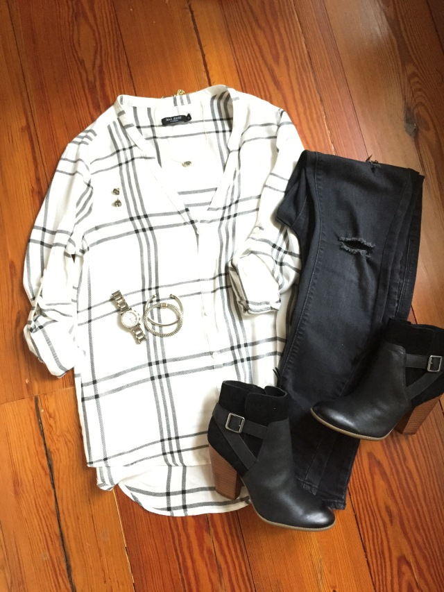 white and black plaid shirt; black jeans; black ankle boots