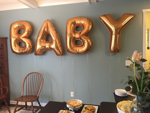 Caroline's baby shower gold balloons