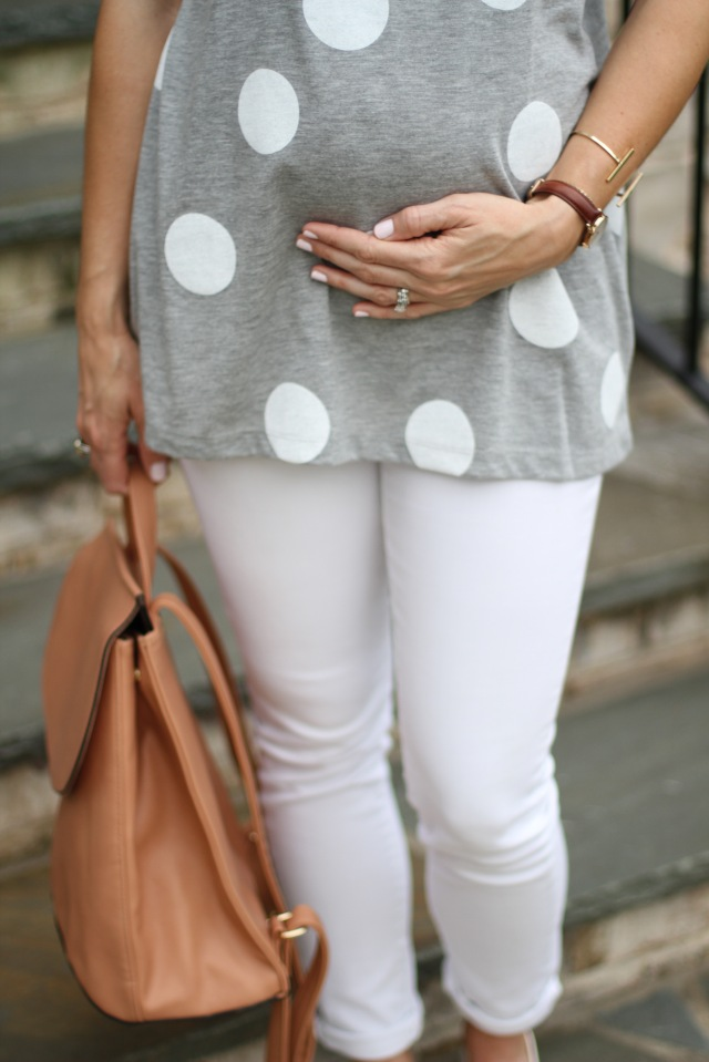 faux leather backpack; maternity look, white jeans and polka dots