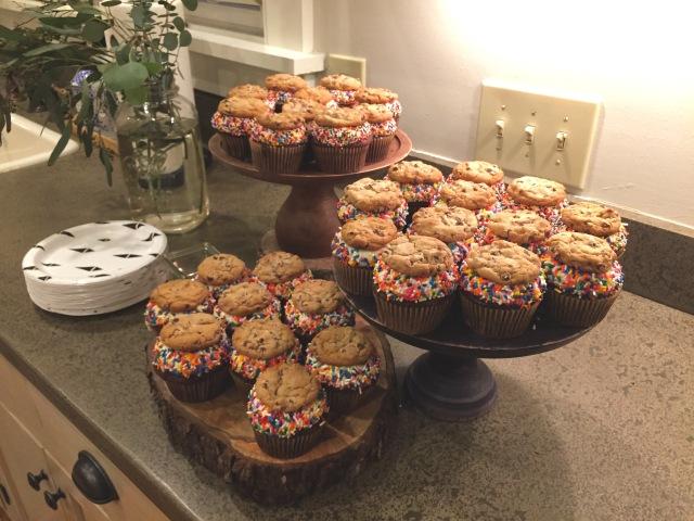rustic baby shower setup; sprinkle cupcakes